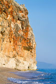 Rocky cliff above the beautiful sand beach at the Adriatic coast