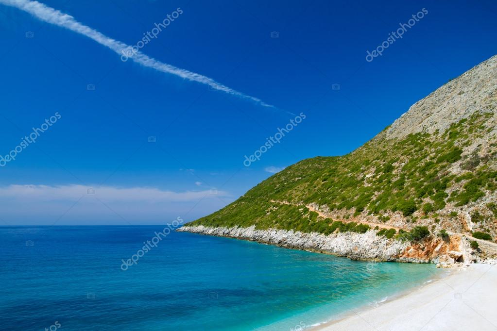 Beautiful sunny beach with white sand and blue water