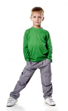 Full length portrait of a happy little boy standing isolated ove