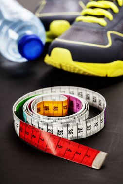 Sport shoes and measuring tape