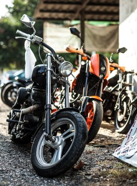 Row of motorcycles parked together