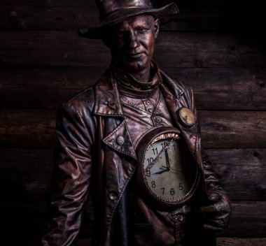 Image of watchmaker in bright fantasy stylization. Fairy tale art photo on grunge wooden background.