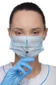 orvos egy maszkot, és a fecskendő