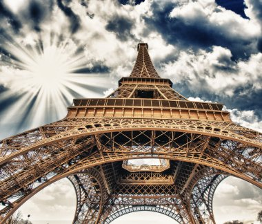 Upward Fisheye view of Eiffel Tower in Paris on a sunny winter m
