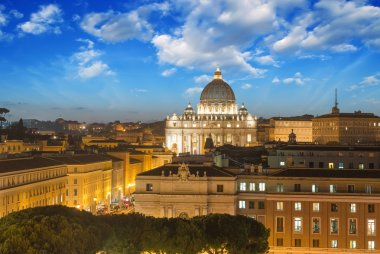 Buildings of Rome with Vatican St Peter Dome in background - sun