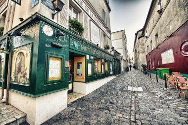 PARIS - DEC 2: Tourists in the beautiful streets of Montmartre,