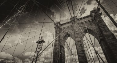 Brooklyn Bridge, New York City. Upward view with beautiful sky