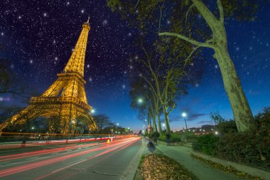 Beautiful car light trails in front of Eiffel Tower