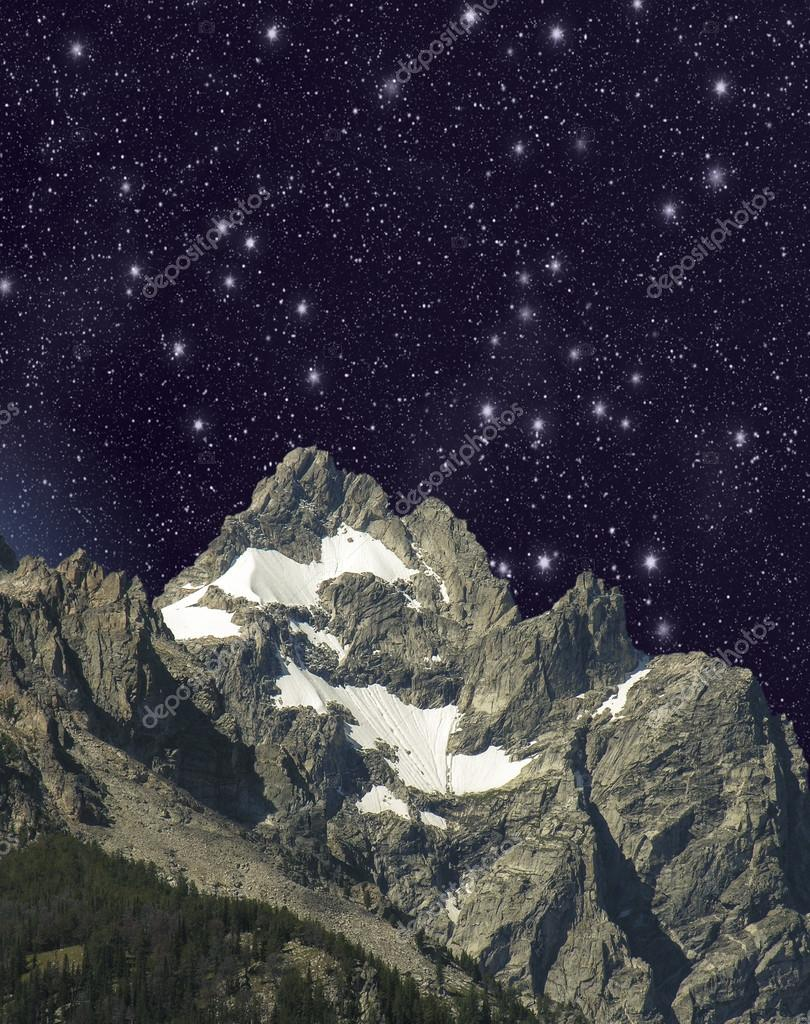 Stars over mountain landscape