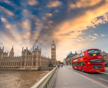 Double Decker red bus crossing Westminster Bridge.