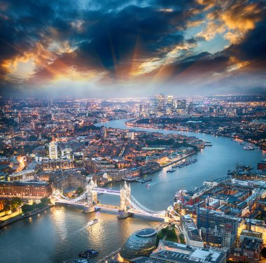 London. Aerial view of Tower Bridge at dusk with beautiful city
