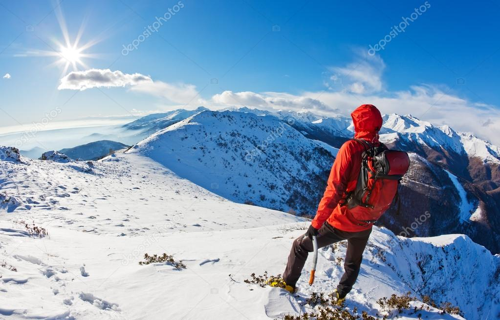 Mountaineer while observing a mountain panorama.