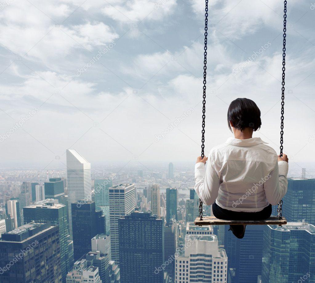 Businesswoman on a swing