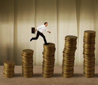 Jumping businessman on money
