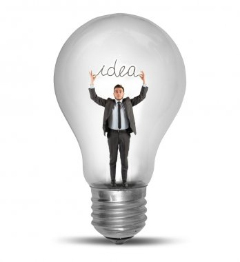 Businessman holding an idea inside a lightbulb