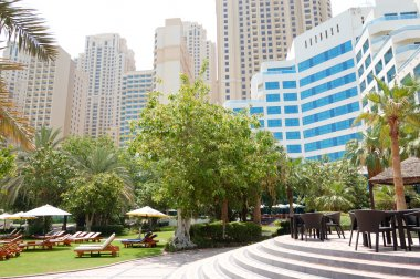 Green lawn and building of luxury hotel, Jumeirah, Dubai, UAE