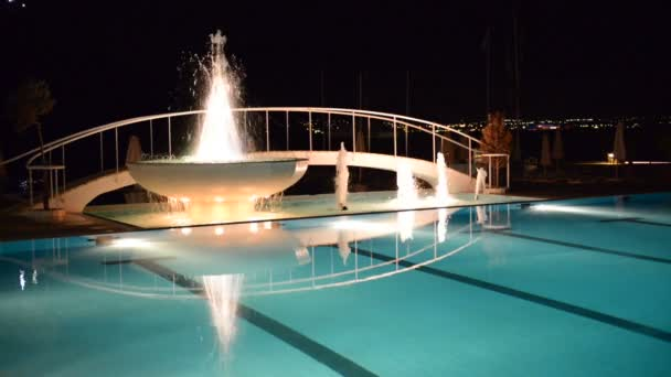 Swimming pool with fountain in night illumination at the luxury hotel, Peloponnes, Greece