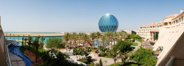 The panorama of luxury hotel and circular building, Abu Dhabi, U