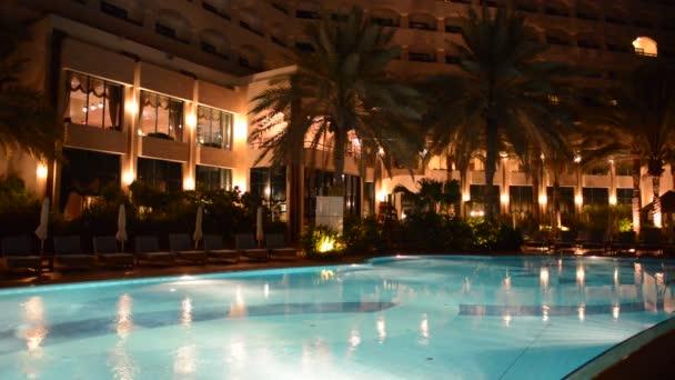 The swimming pool at luxury hotel in night illumination, Ajman, UAE