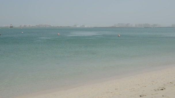 Beach of the luxury hotel with a view on Palm Jumeirah man-made island, Dubai, UAE