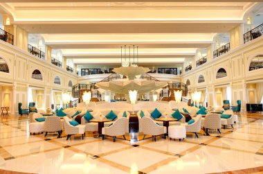 Lobby interior of the luxury hotel in night illumination, Ras Al