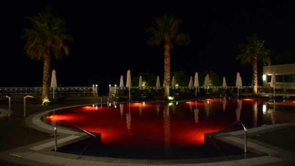Swimming pool at the luxury hotel with red color of water, Halkidiki, Greece