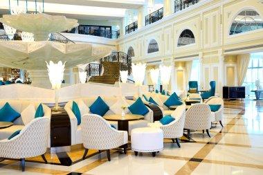 Lobby interior of the luxury hotel in night illumination, Ras Al