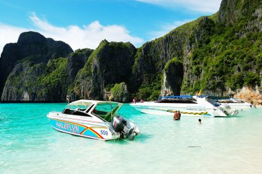 KOH PHI PHI, THAILAND - SEPTEMBER 13: Motor boats on turquoise w