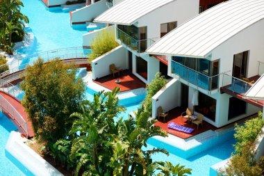 Modern villas with swimming pool at luxury hotel, Antalya, Turke
