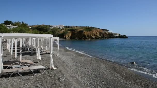 Panning the huts on beach at luxury hotel, Crete, Greece