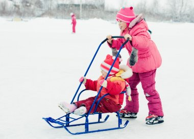 Happy children in winter outdoors