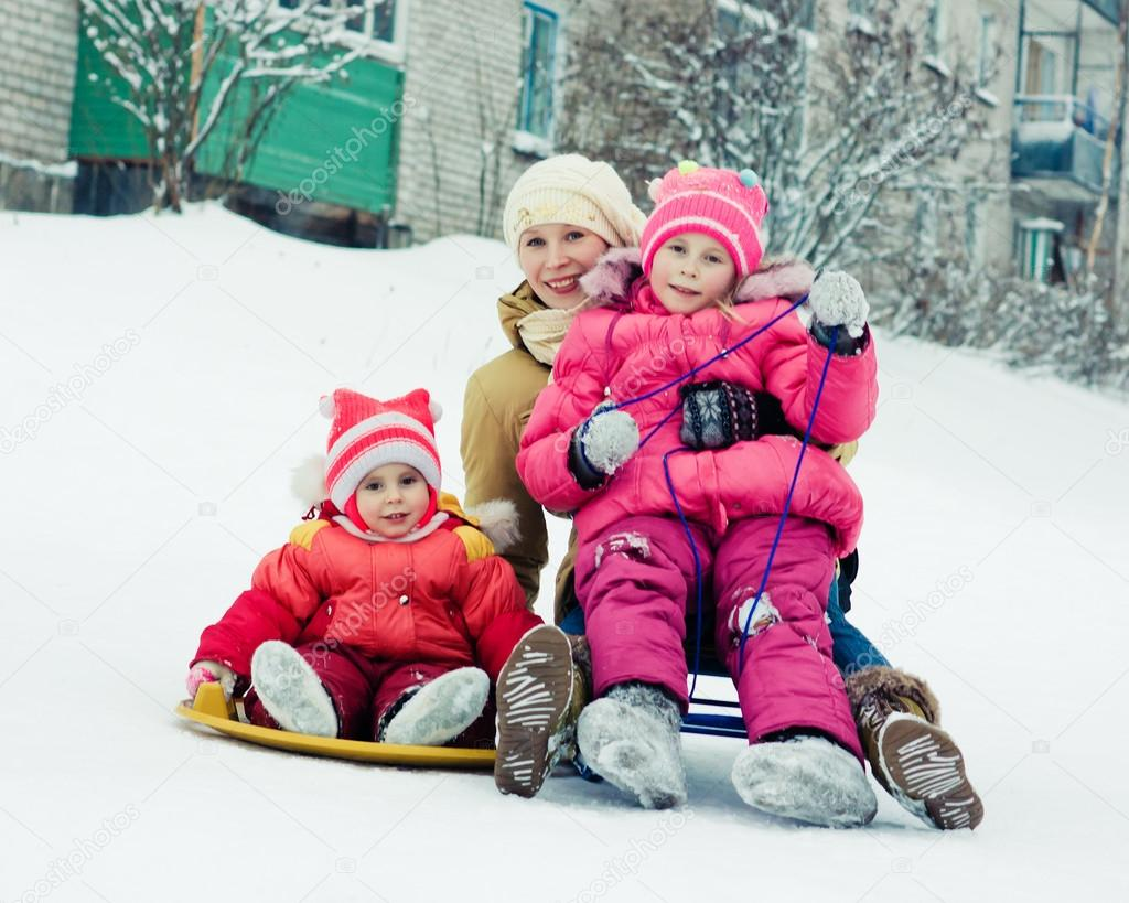Mother with children on the sled.