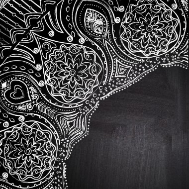 Chalk floral corner on chalkboard blackboard. Ornamental round lace pattern, circle background with many details, looks like crocheting handmade lace on grunge background, lacy arabesque designs.