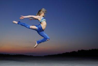 woman jump at night
