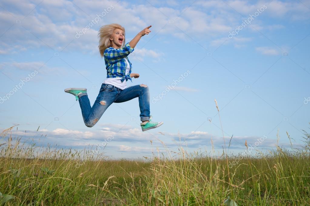 Woman jump in green grass field