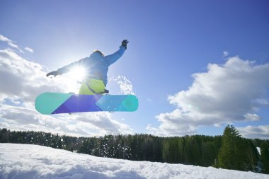 Young man on the snowboard jumping over the slope in winter stock vector