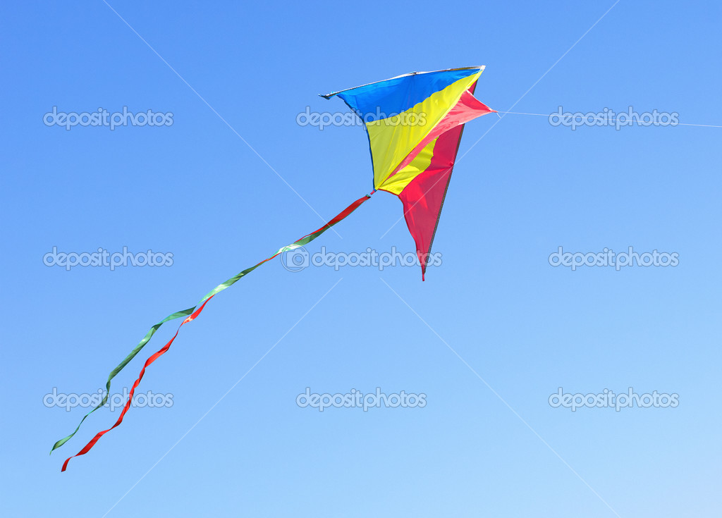 Kite Against The Blue Sky Symbol Of Dreams And Happiness Stock