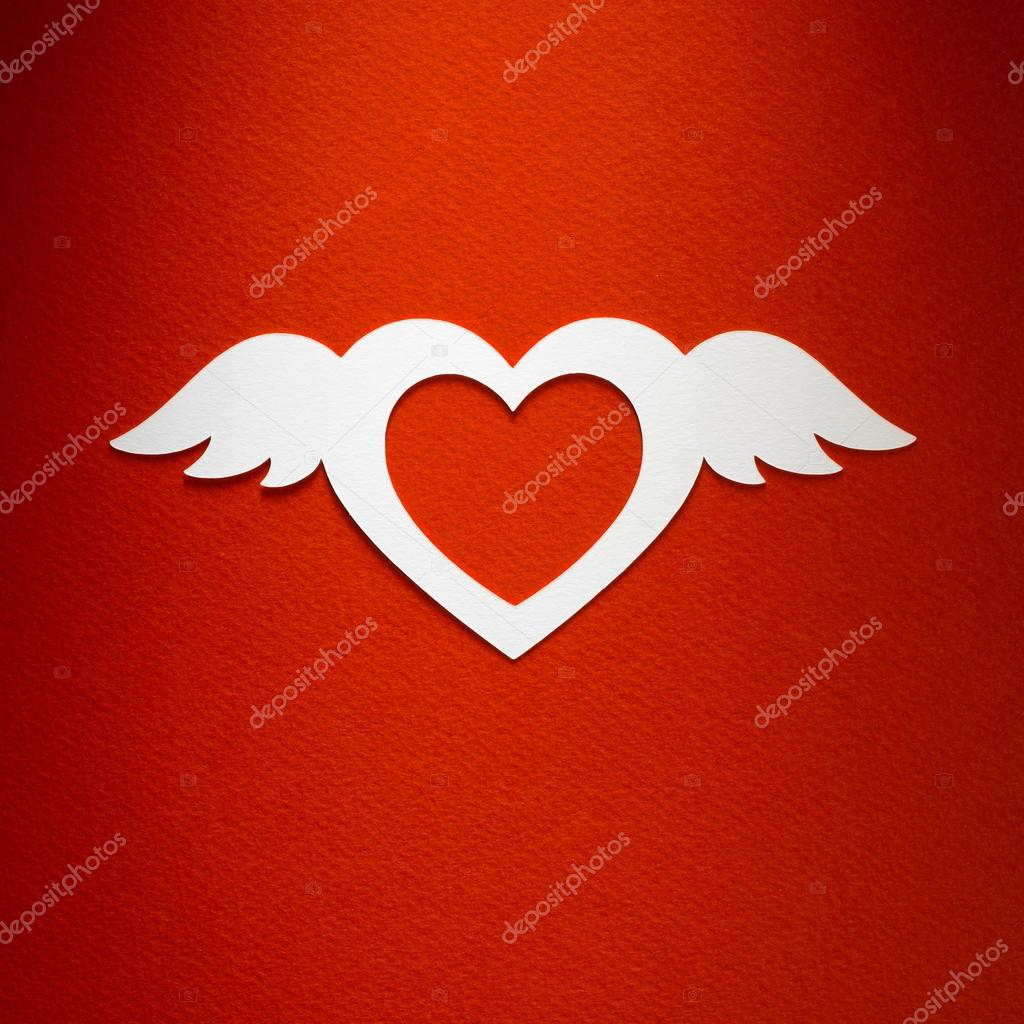 valentine heart with angel wings made of paper on red paper