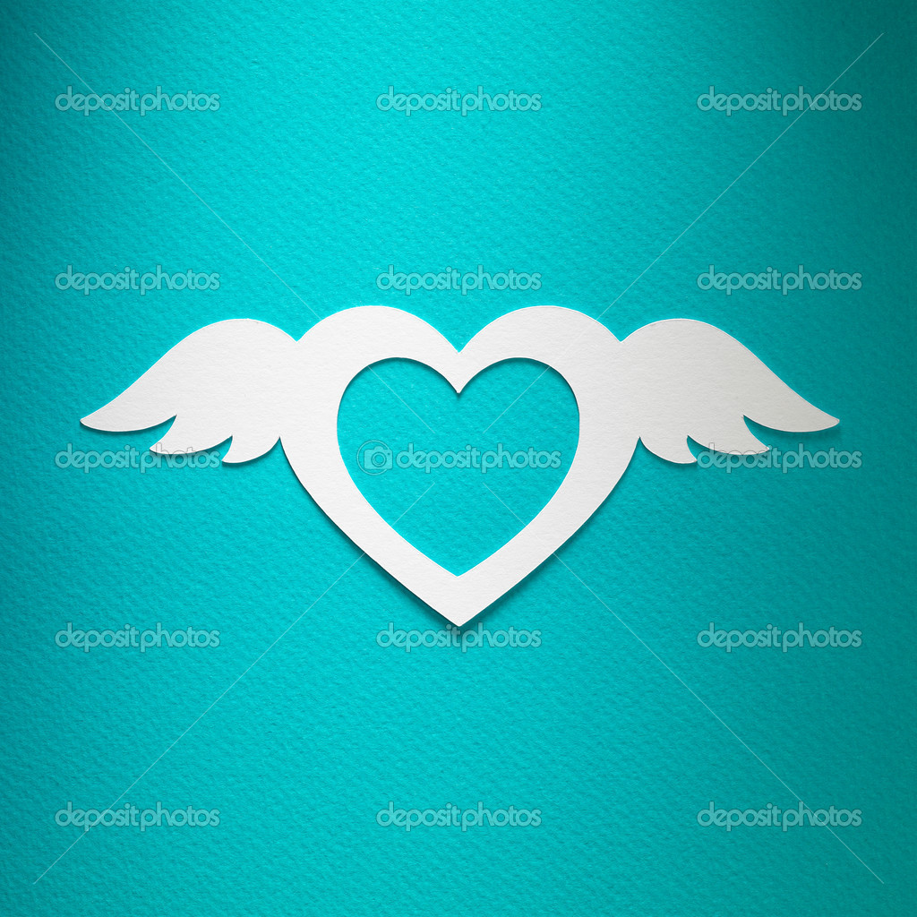 valentine heart with angel wings made of paper on blue paper