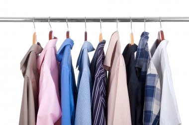 Row of colorful row shirts hanging on hangers