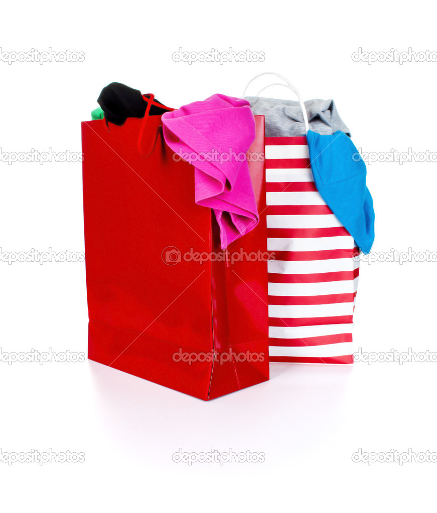 Paper shopping bags full of clothes — Stock Photo © urfingus #37819517