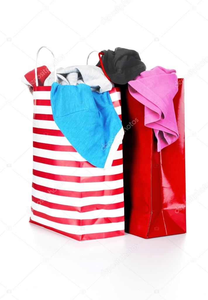 Paper shopping bags full of clothes — Stock Photo © urfingus #37819557
