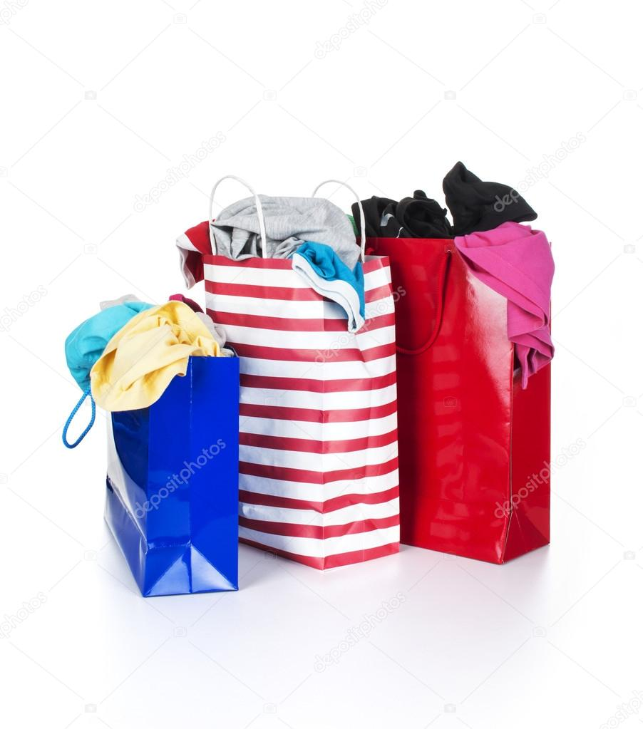 Paper shopping bags full of clothes — Stock Photo © urfingus #37819603
