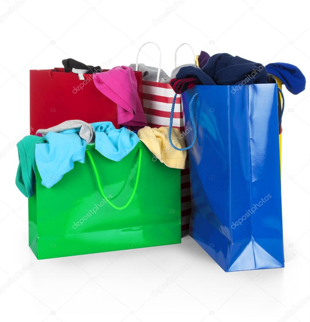 Paper shopping bags full of clothes — Stock Photo © urfingus #37819607