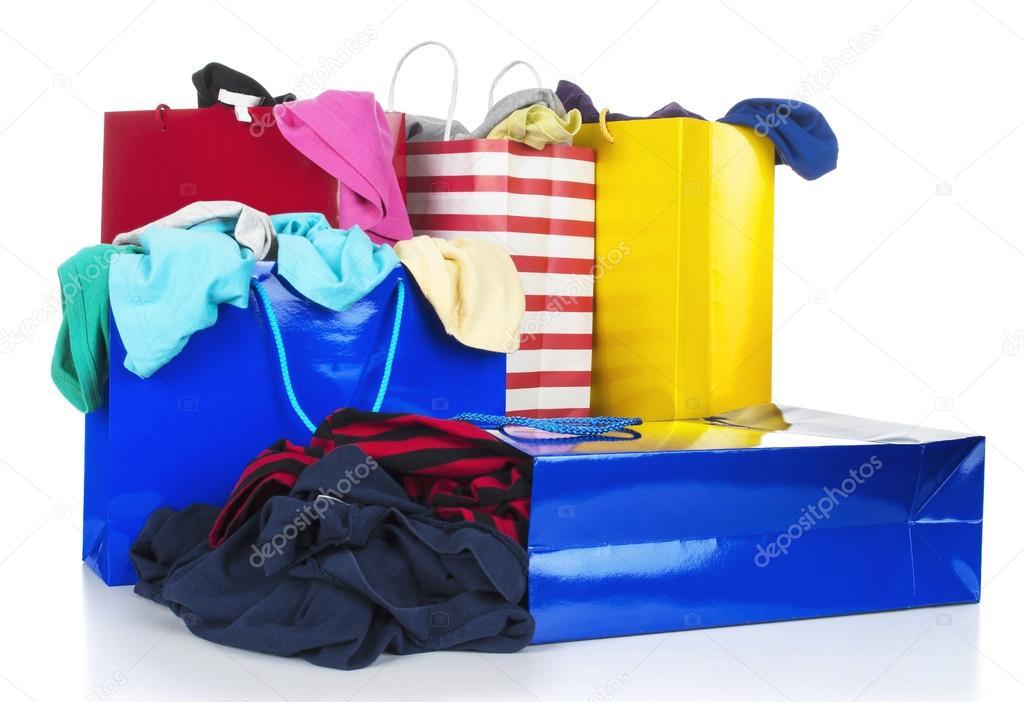 Paper shopping bags full of clothes — Stock Photo © urfingus #37819621