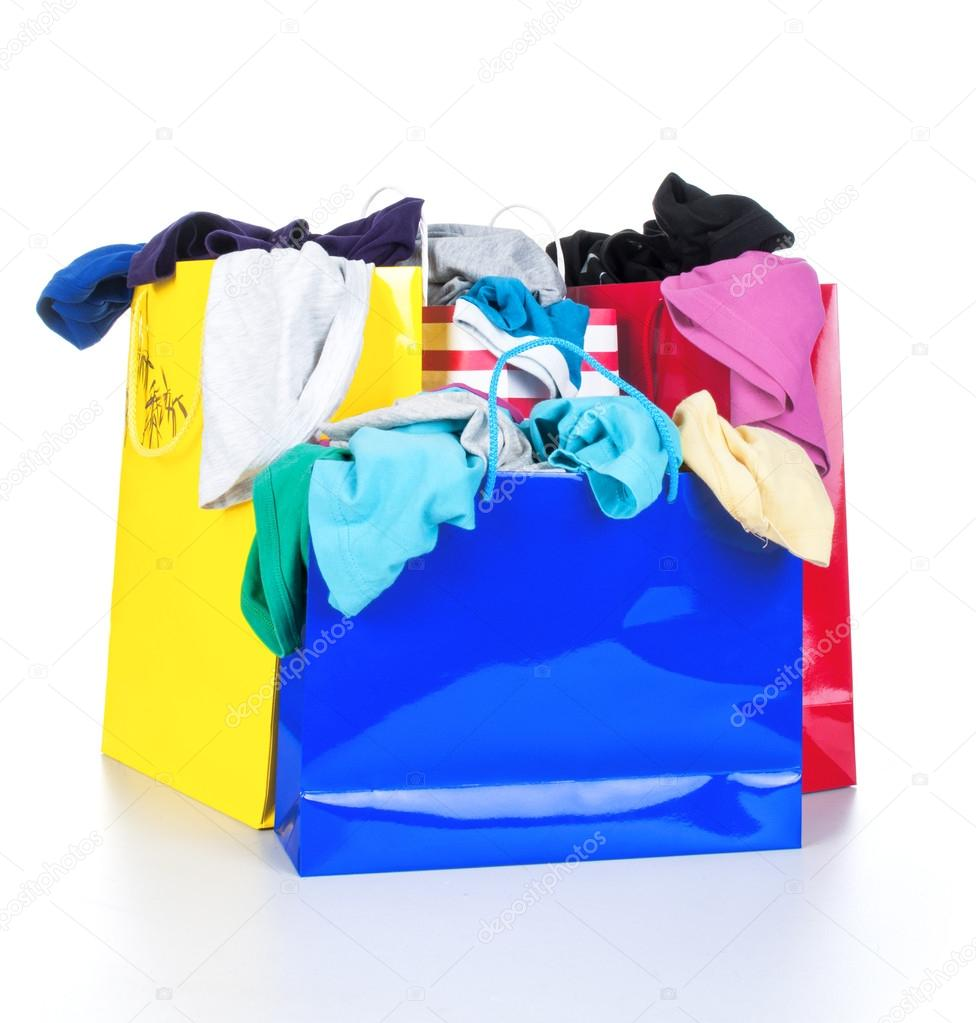 Paper shopping bags full of clothes — Stock Photo © urfingus #37819667