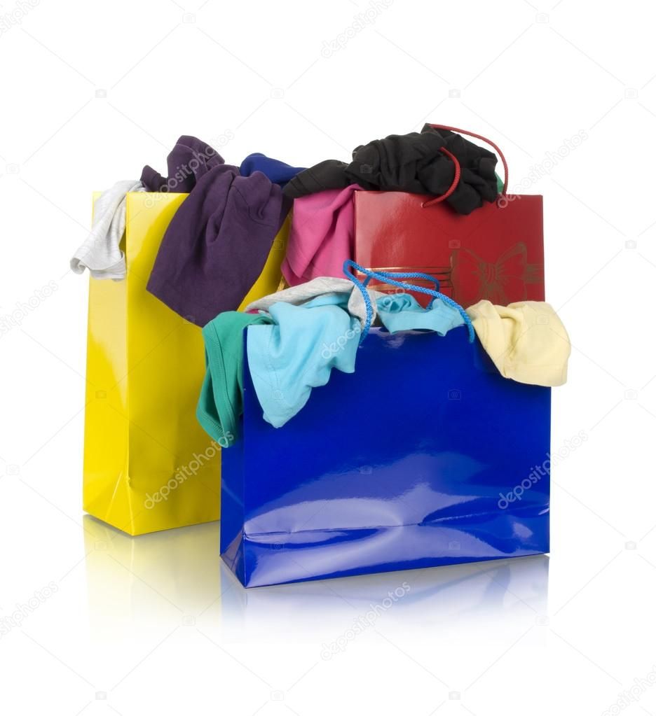 Paper shopping bags full of clothes — Stock Photo © urfingus #37819673