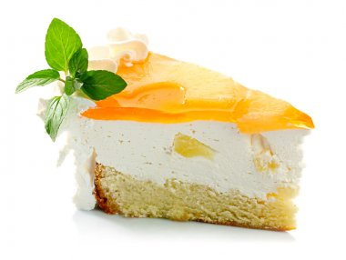 Piece of pineapple cake cream and mint leaves isolated