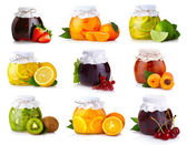 Photo Set of glass jars with exotic fruits jam isolated