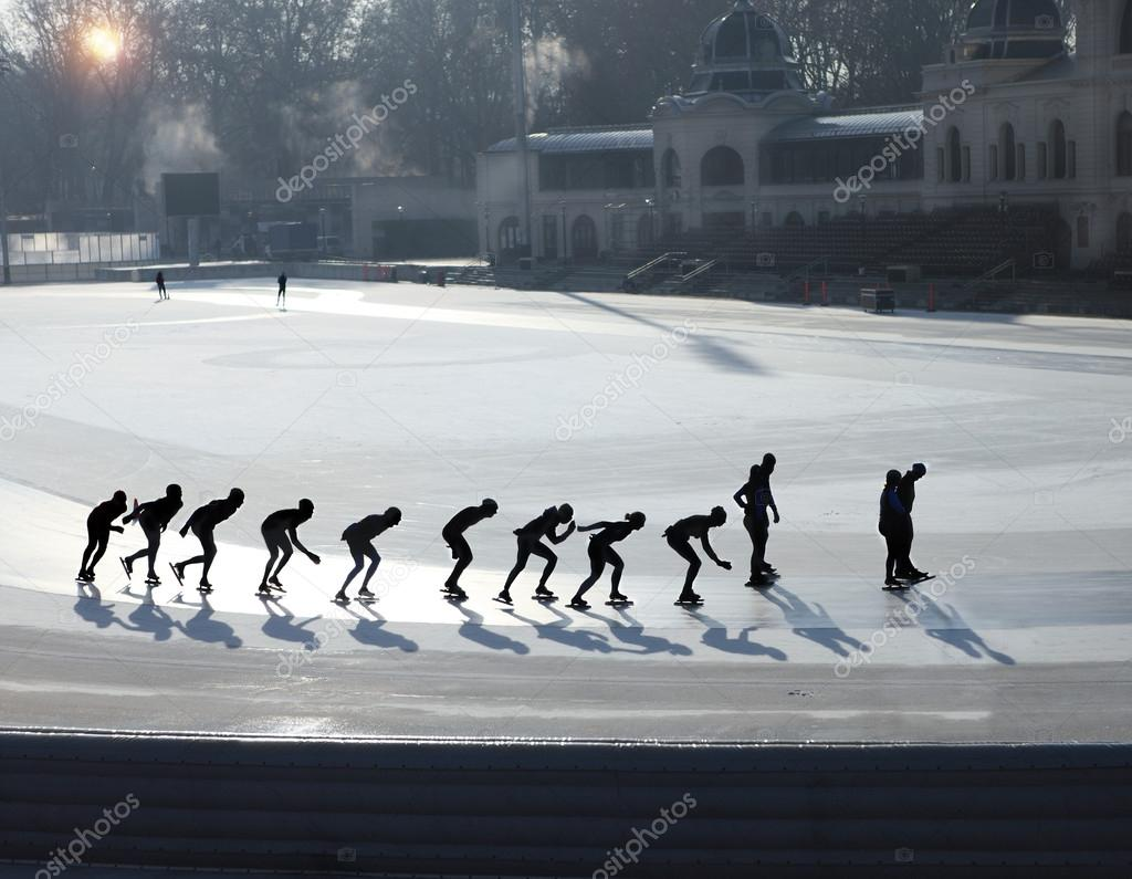 Silhouettes of ice skating
